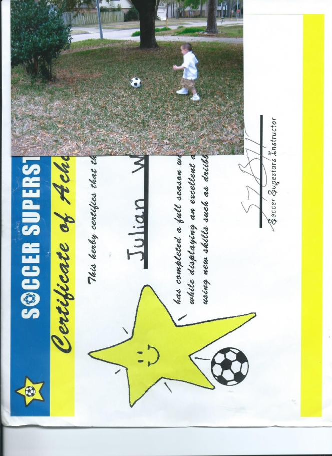 JULIAN GETTING HIS KICKS AND SOCCER SUPERSTARS CERTIFICATE