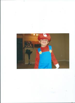 JULIAN'S MARIO COSTUME.HALLOWEEN.2011 BEFORE CHANGING MIND TO BE SUPERMAN