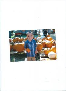 JULIAN AT THE PUMPKIN PATCH WITH MOMMY, ALMOST 5 YRS. OLD 2011