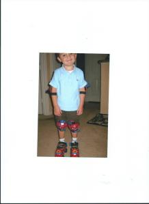 JULIAN IN FIRST PAIR OF SKATES-SPIDERMAN.4.5 YRS OLD