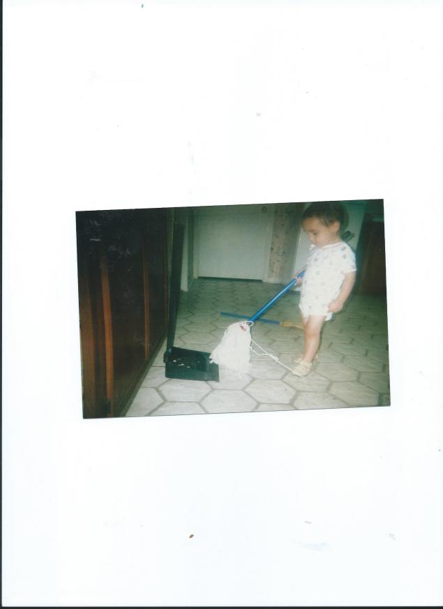 JULIAN MOPPING UP THE FLOOR WITH HIS NEW CHILD'S SIZE BROOM.2009 001