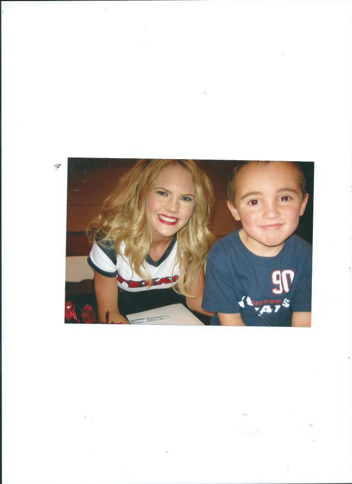 Julian with Texans Cheerleader.4.5yrs.2011