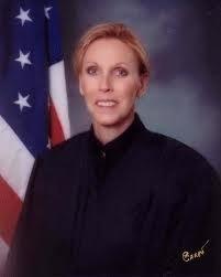 LISA MILLARD.PHOTO WITH FLAG